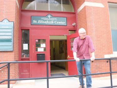 Director Douglas Kennedy in front of the St. Elizabeth Center