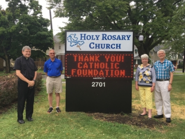 Fr. John Jacquel, Joe Mattis, and Pat & Richard Marshall appreciate the grant from the Foundation that helped them purchase a new sign for their church.