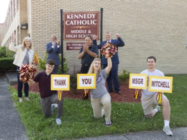 Kennedy Catholic students and administrators celebrate Msgr. Mitchell's bequest. Photo credit Natalie Stanton