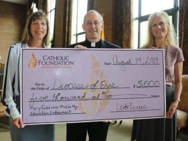 Karen Burton-Horstman, Fr. Nicholas Rouch, Lisa Louis