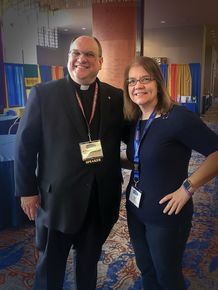 Sue Berdis and Father Frank S Donio